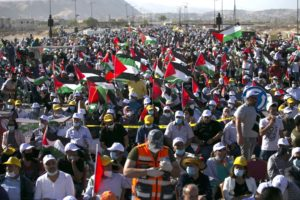Palestinians participate in a big rally to protest against Israel's plan to annex parts of the occupied West Bank, in Jericho on June 22, 2020. (Photo by ABBAS MOMANI / AFP)